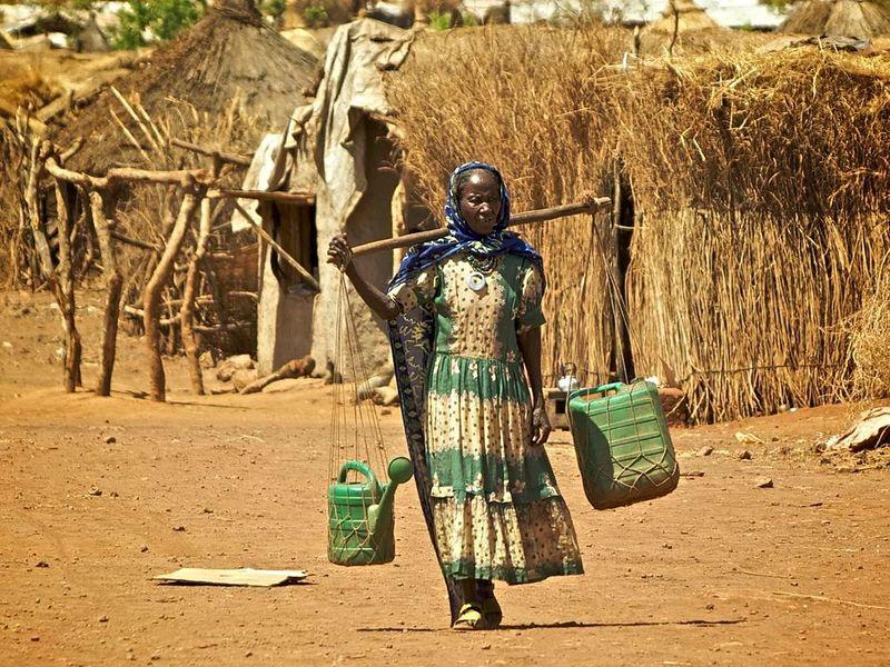 Kunama woman carrying water in Shimelba Refugee Camp