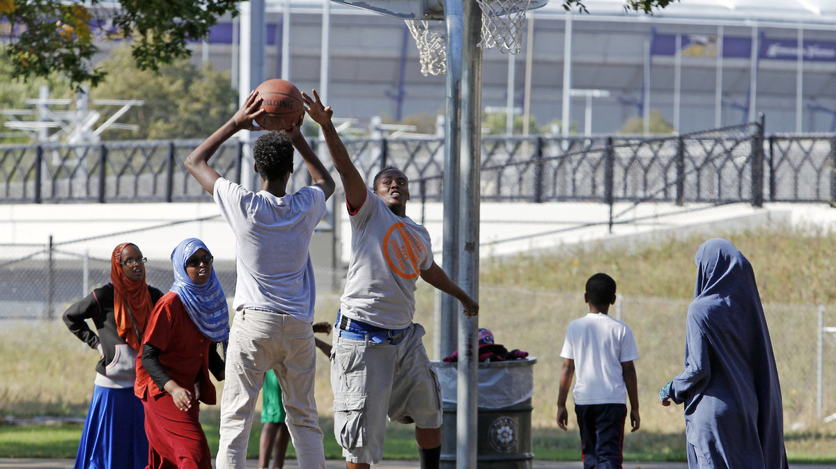 Somali-American youth playing basketball in Minneapolis <br />
