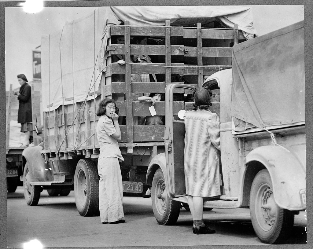 Japanese residents being loaded up for internment camps