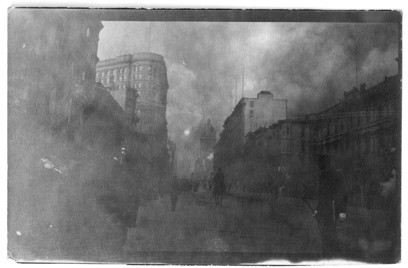"""During fire. Emporium and James Flood buildings doomed. Market St. looking East."""