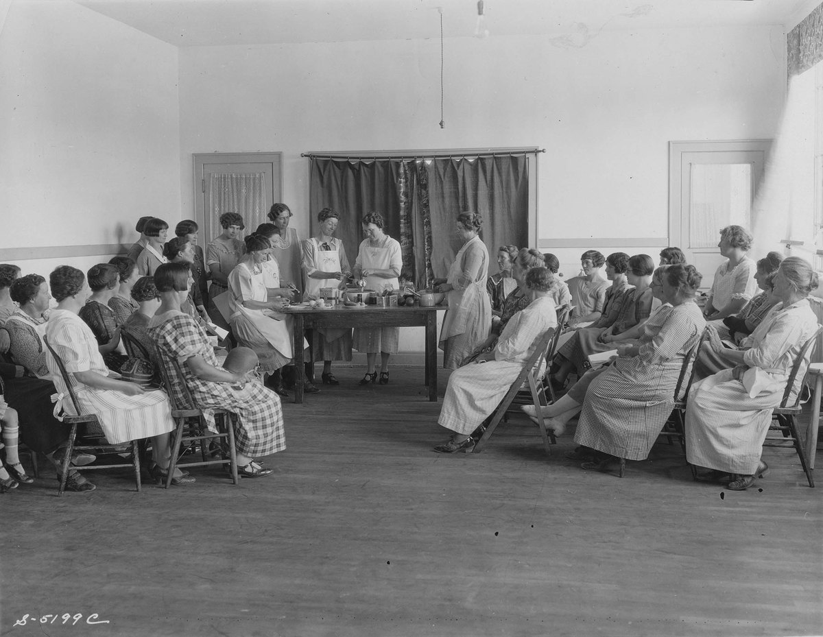 Women giving a cooking demonstration;