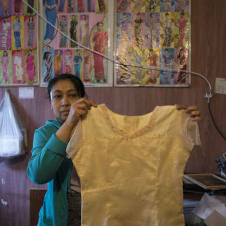 Khin Mar Cho holding yellow dress