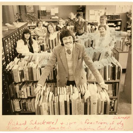 Richard Schockmel, Dixie Drage, Reed Painter, Joy Fuhriman, Geniel Pond, Eliana Prichett, Lori Buttars, & Kathy Schockmel with carts of books