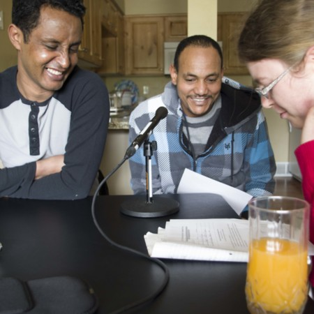 Berhane Debesai Abraha (left), Afeworki Woldemichael (middle), and Hilary Warner-Evans (right) filling out the translater form, May 17, 2015