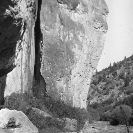 Large rock formation near a riverside in Logan Canyon