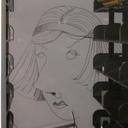 Merrill Library graffiti - woman wearing headband<br />