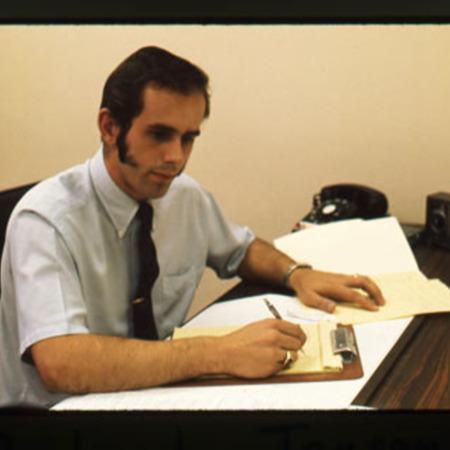Richard Jensen sitting at his desk<br />