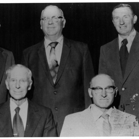Group of five men, three with glasses