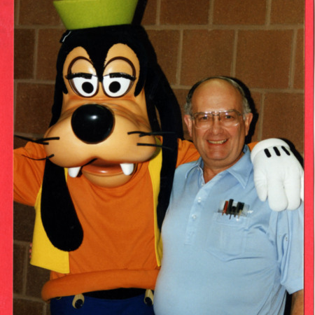 Chester Redd with Mickey Mouse and Goofy.