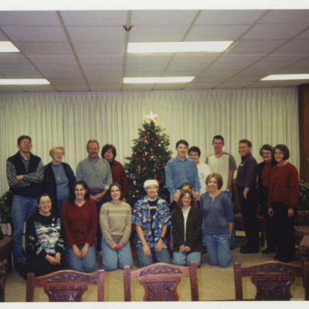 Special Collections' Christmas Party, left to right: Nick Edvarchuk, Virginia Parker, Bob Parson, Sherry Brewer, Noel Carmack, Kenny Carmack, Camille Carmack, David Duvall, Steve Sturgeon, Beverly Muri, Ann Buttars. Front row: Becky Skeen, Julie Kenyon<br />