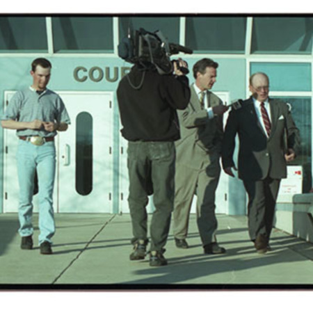 Reporter questioning John Jeppson (right) with Christopher Doerr (left) shown leaving the 1st District Court after a preliminary hearing charging the watchmen with assault