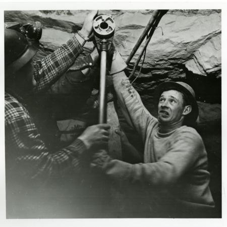 Two Men Struggling to Find Uranium