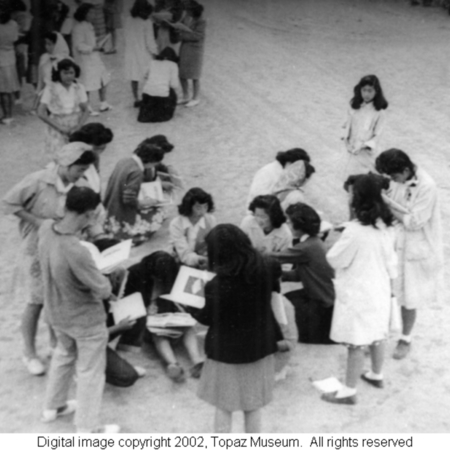 Sekerak_Students_signing_each_other_s_1945_yearbooks.jpg