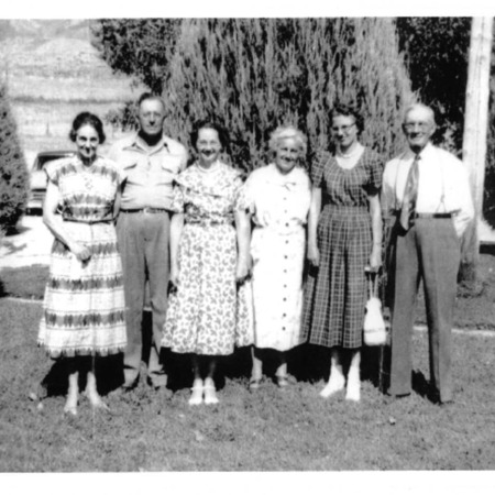Group of men and women outside