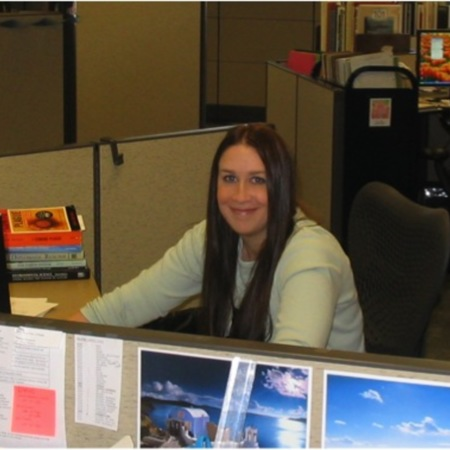 Andrea Payant working at her desk