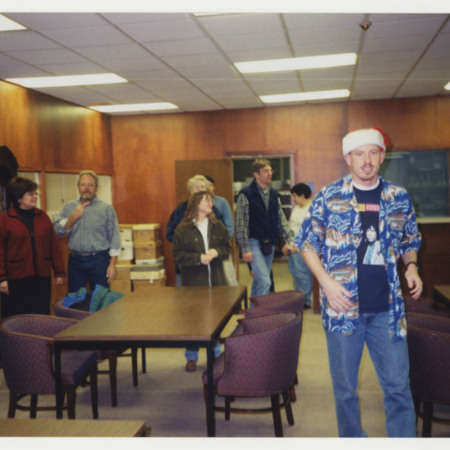 Special Collections' Christmas Party, left to right: David Duvall, Sherry Brewer, Bob Parson, Jolynn Hunting, Virginia Parker, Noel Carmack, Nick Edvarchuk, Camille Carmack, Fred Gooch<br />