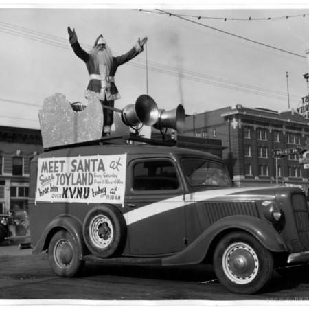 Vehicle advertisement for Santa coming to KVNU, c. 1945