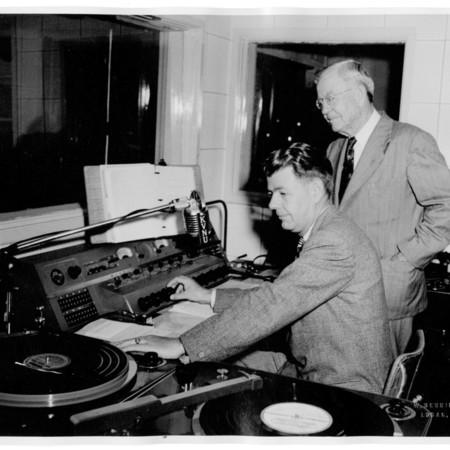 Reed Bullen and his father Herschel in KVNU studio control room, 1948.