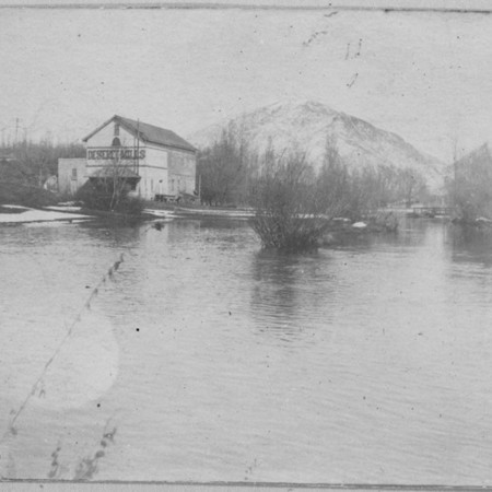 Deseret Mill on the north branch of the Logan River while the river is flooding, Cache County, Utah, ca. 1899