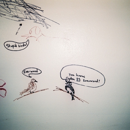 "Merrill Library graffiti - ""Everwood"" - drawing of two birds and a dog with captions<br />"