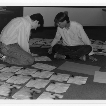 Noel Carmack & Brad Cole laying out documents damaged in the Old Main fire