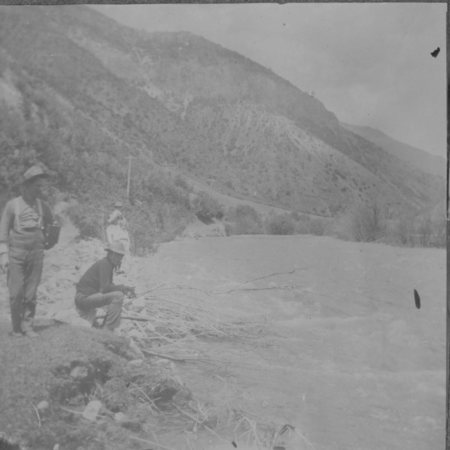 Men on the bank of a stream in Logan Canyon