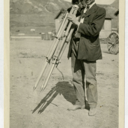 Dolph Andrus holding motion picture camera