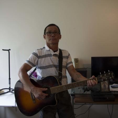 Tun Lay posing with his guitar