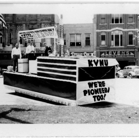 Pioneer Day parade-float advertising the new radio station in downtown Logan.