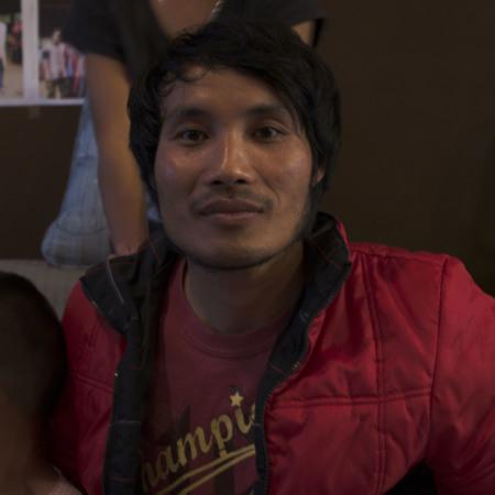 Eh Htoo smiles beside Kyaw Eh's nephew and niece