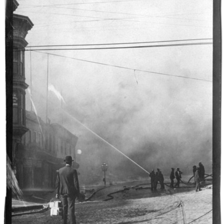 """""""Market and Elis looking east. Fireman at work, man taking boxes of cigars away."""""""