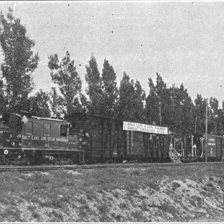 Agricultural exhibit train arriving at West Jordan;