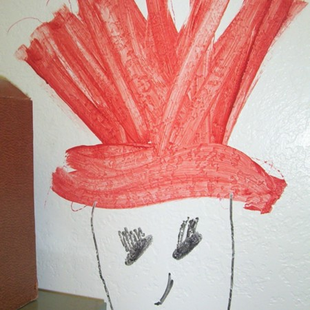 Merrill Library graffiti - drawing of a man wearing red hat
