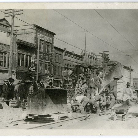 Men working on railway tracks on Logan, Utah's Main Street (2/2)