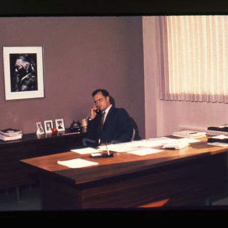 Max Peterson at his desk
