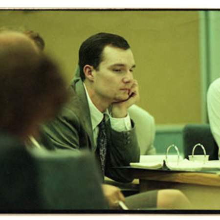 Chris Doerr, center, and Arthur Peasnall seen partially on the right at preliminary hearing