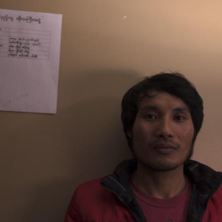 Eh Htoo with dinner schedule written in Burmese