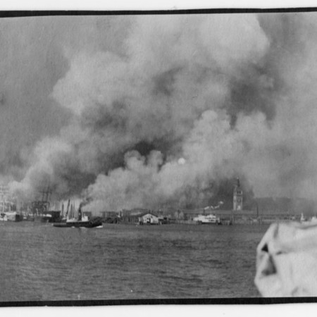 """Quarter mile from ferry showing entire waterfront on fire and the only remaining building of any size in town, the Ferry Building."""