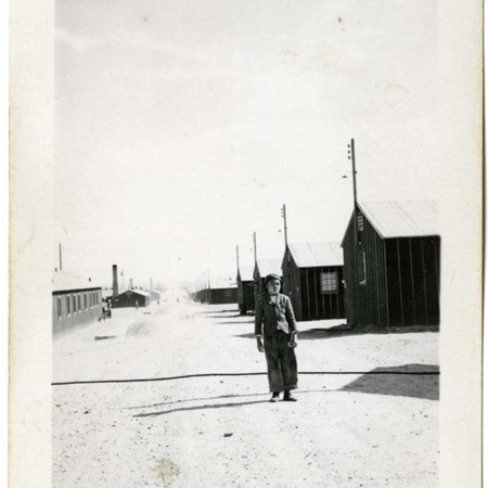 Boy standing in front of barracks