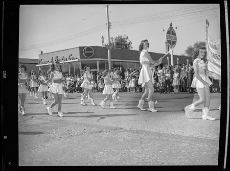 Girls cheer team in the homecoming parade, 1950