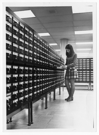Student using card catalog, Merrill Library