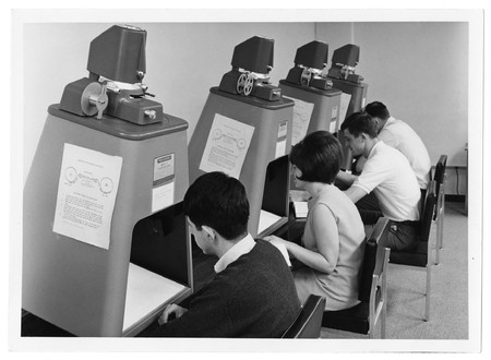 Students viewing microfilm in the Merrill Library