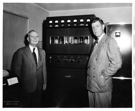 Herschel Bullen, Jr. and Reed Bullen in front of KVNU's Collins transmitter