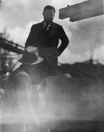 Frederick P. Champ watching the laying the cornerstone of the Merrill Library, 1930
