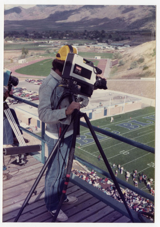 The Cable Company staff filming an Aggie football game, 1983.