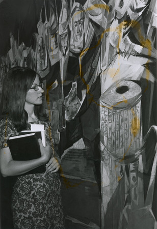 Student looking at Allegory of Knowledge mural in Merrill Library, 1968