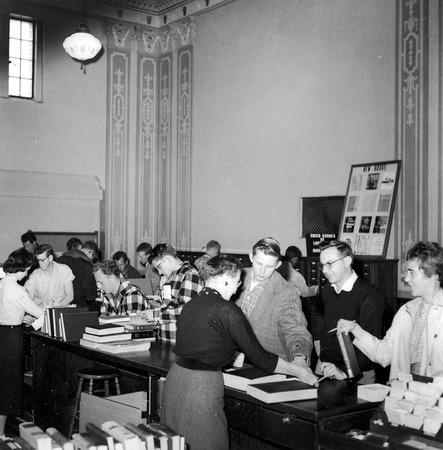 Loan desk in the Merrill Library, 1950s