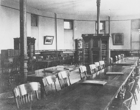 View of the interior of the library, located in the north wing of Old Main, 1900