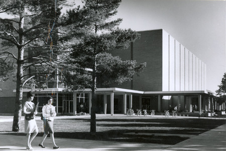 Students walking past the Merrill Library, 1967