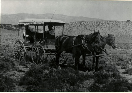 Two unidentified men riding in a carriage in Blacksmith Fork Canyon, Utah, ca. 1904